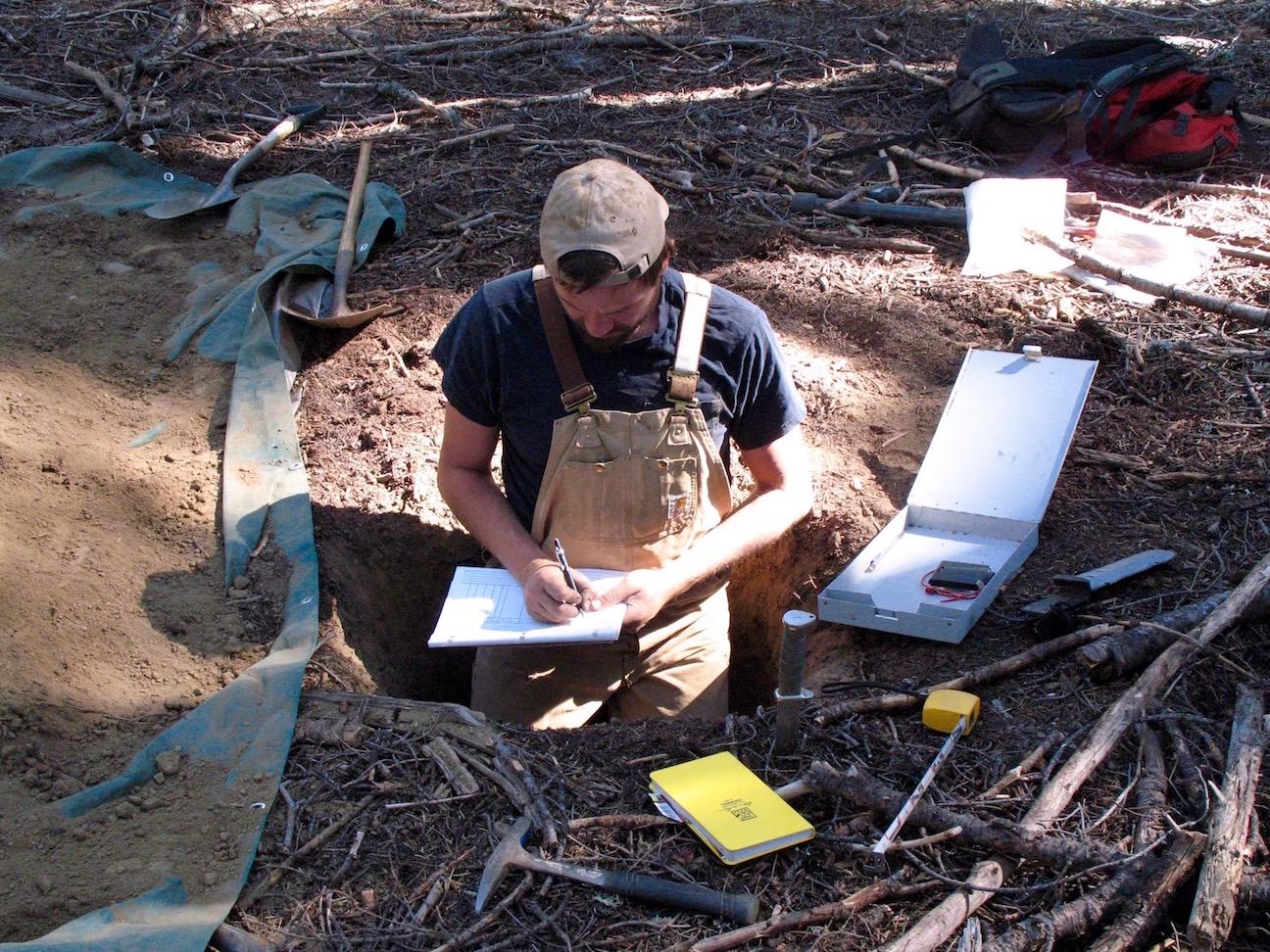 scientist samples soil and rocks