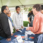 parents and students talking with an adviser